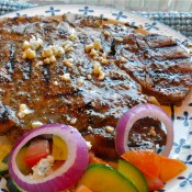 Greek Seasoned Porterhouse Steak with Cucumber and Tomato Salad