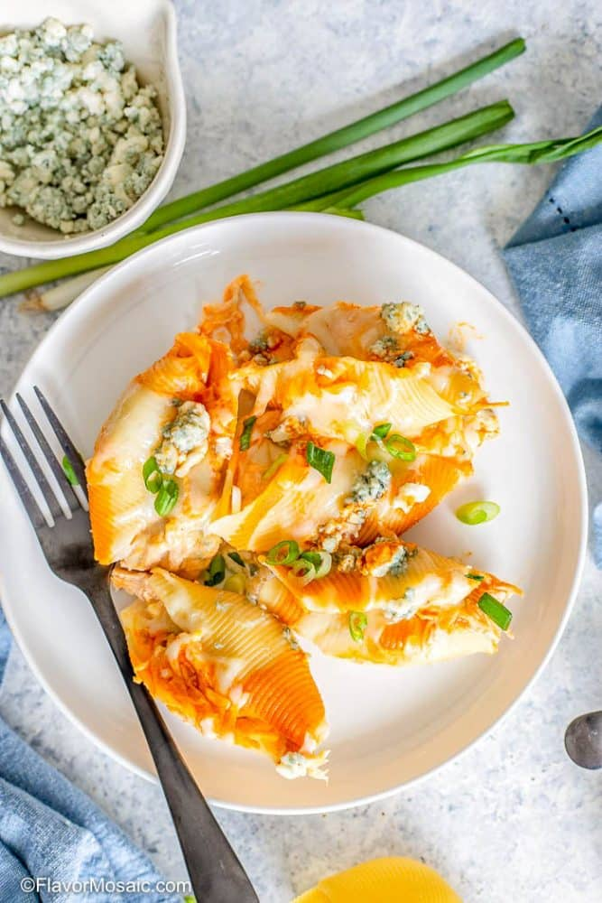 Overhead view of single serving of Buffalo Chicken Stuffed Shells on White Plate.