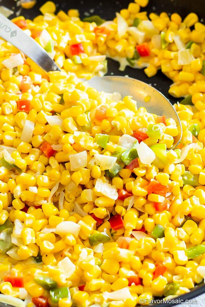 Close up of Maque Choux corn in black skillet.