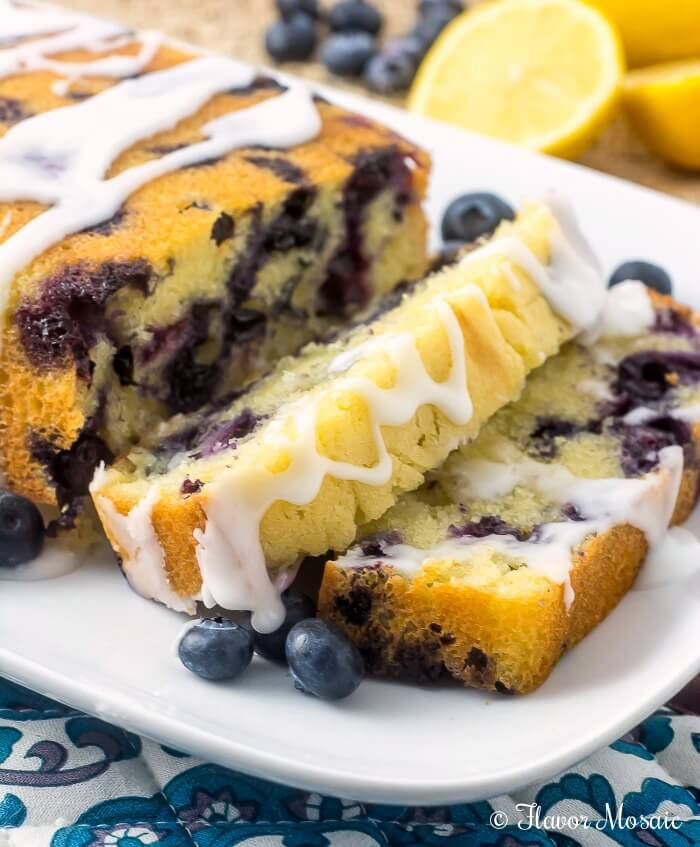 This Glazed Lemon Blueberry Pound Cake is a moist, luscious, buttery, lemon pound cake made with beautiful fresh blueberries throughout and glazed with a sweet, tangy lemon icing.