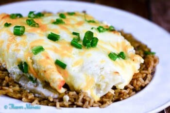 Cheesy Tomatillo Verde Sour Cream Chicken Enchiladas are cheesy, creamy, spicy, chicken enchiladas that are easy to make and your family will love.