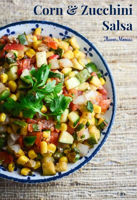 Corn and Zucchini Salsa is a perfect summer recipe to use up those tomatoes, zucchinis and corn. It is delicious on everything, especially salads, chicken, or fajita tacos.