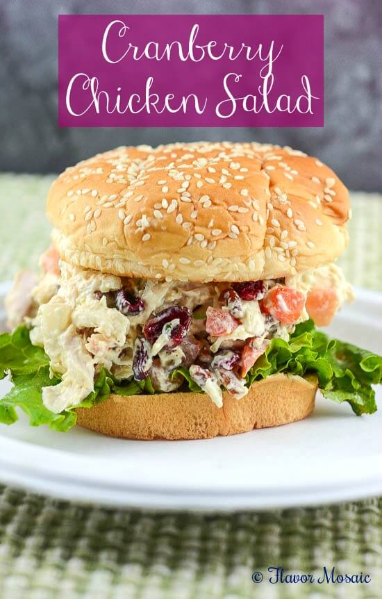 This Cranberry Chicken Salad Sandwich, with cranberries, pecans (or walnuts), tomatoes, onions and celery, is a delicious way to use up leftover chicken without heating up the kitchen. Read more at https://flavormosaic.com/cranberry-chicken-salad-sandwich/#4XYAOa1UGldre93U.99