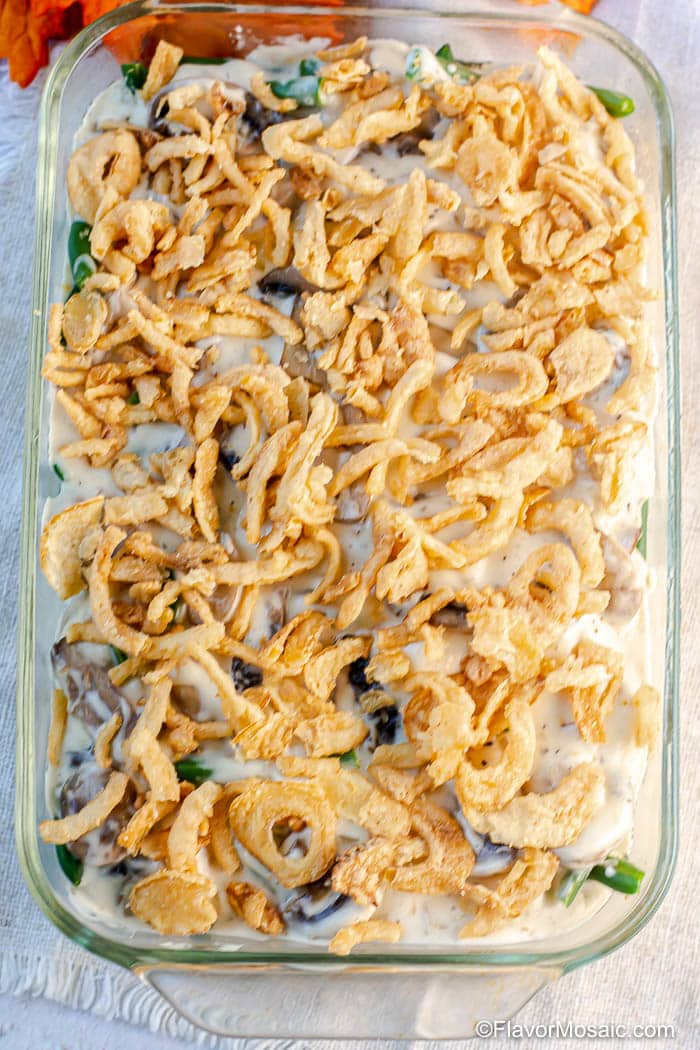 Overhead view of Green Bean Casserole topped with French Fried Onions just before it goes in the oven.