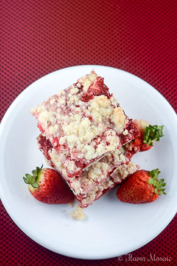 These easy Strawberry Crumb Bars, with a buttery crust, sweet fresh strawberry filling, and crunchy butter crumb topping make wonderful dessert bars to take to a summer party, picnic, or potluck.