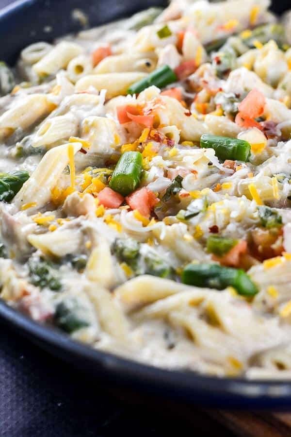 Cheesy Chicken Skillet Pasta is an easy 30-minute one pot meal that is perfect for a quick and easy weeknight dinner.