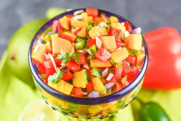 Mango Habanero Salsa is a quick and easy, fresh, healthy, sweet and spicy salsa made with mangoes and habaneros and fits into any low fat, Paleo, or gluten-free diet.