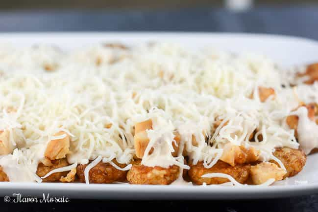 Chicken Alfredo Italian Totchos, inspired by the Italian style nachos at one of our favorite restaurants, use tater tots instead of tortilla or pasta chips to make a quick and easy, kid-friendly weeknight meal.