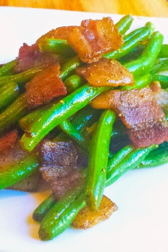 This Balsamic Bacon Green Beans recipe, glazed with balsamic vinegar and bacon, is a great alternative to the traditional Thanksgiving green bean casserole.