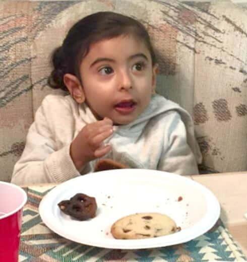 Maria enjoying reindeer and chocolate mint chip cookies