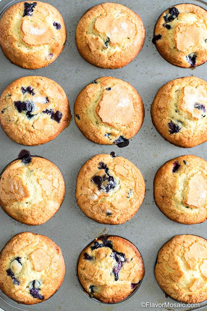 Overhead view of muffin tin of a dozen Jordan Marsh blueberry muffins.
