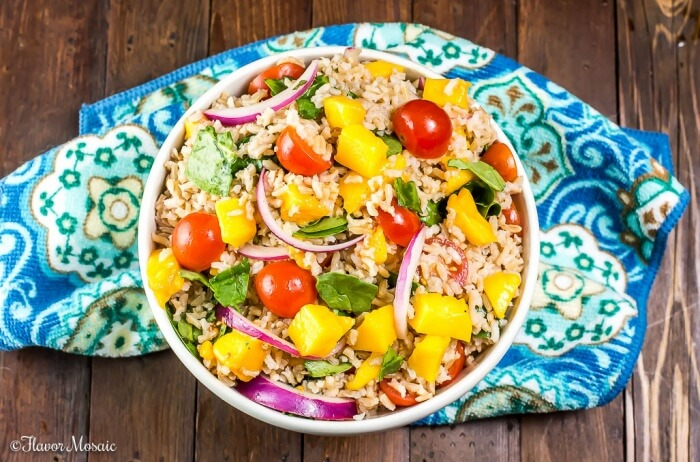 Mango Spinach Rice Salad, with brown rice, mango, baby spinach, tomatoes, and red onions in a red wine vinaigrette, makes a delicious and colorful side dish for a fish dinner, barbecue or potluck. #ProntoPerfectRice #Ad ~ https://flavormosaic.com
