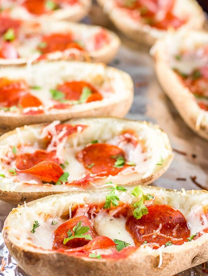 These PEPPERONI PIZZA POTATO SKINS taste like pizza on a potato, and make a delicious, fun and kid-friendly appetizer for a party or for tailgating!