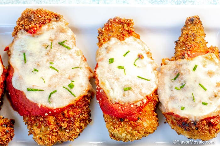 Overhead view of 3 Classic Chicken Parmesan Chicken Breasts fresh out of the oven.