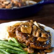 Salisbury Steak with onions, mushrooms, and brown gravy. Serve with mashed potatoes.