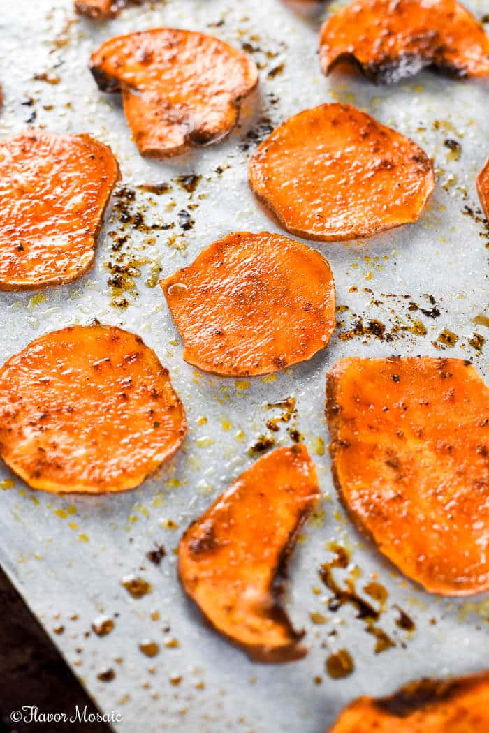 These Homemade Baked Sweet Potato Chips are crispy, spicy, and healthy and fit into a Paleo, Vegan or Gluten Free diet as a healthy snack recipe.
