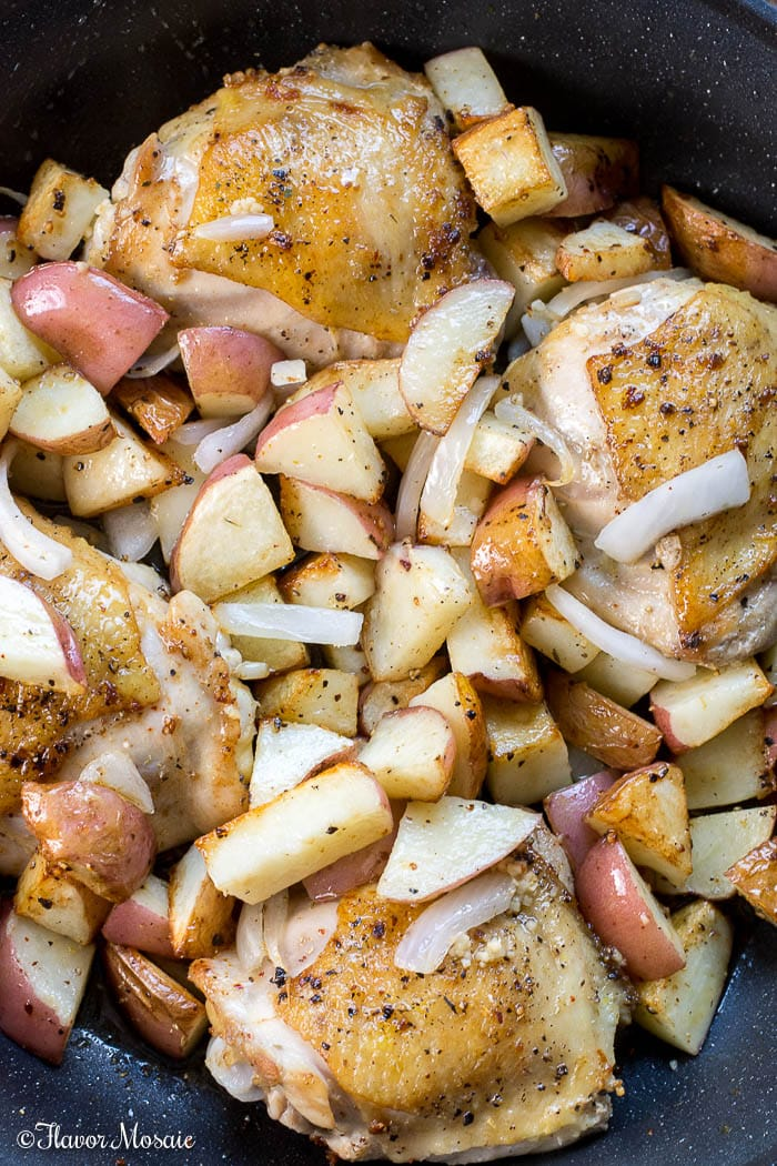 Chicken and Potatoes cooking in a skillet for Chicken Vesuvio - Dinner in a Skillet