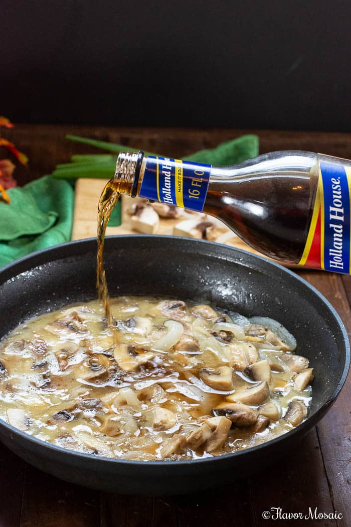 Stuffed Chicken Marsala - pouring Holland House Marsala Wine into skillet with mushrooms and onions for marsala sauce.