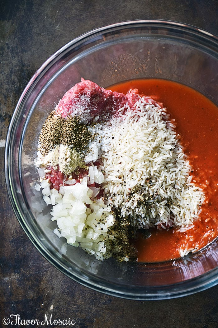 Porcupine Meatballs Process Shot #1 - Mix meatball ingredients in glass bowl with dark gray background.