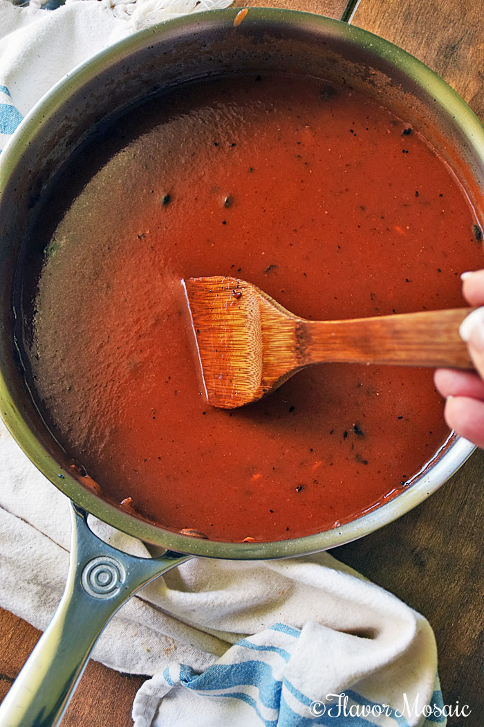 Porcupine Meatballs Process Shot #8 - Showing meatball sauce in a pan.