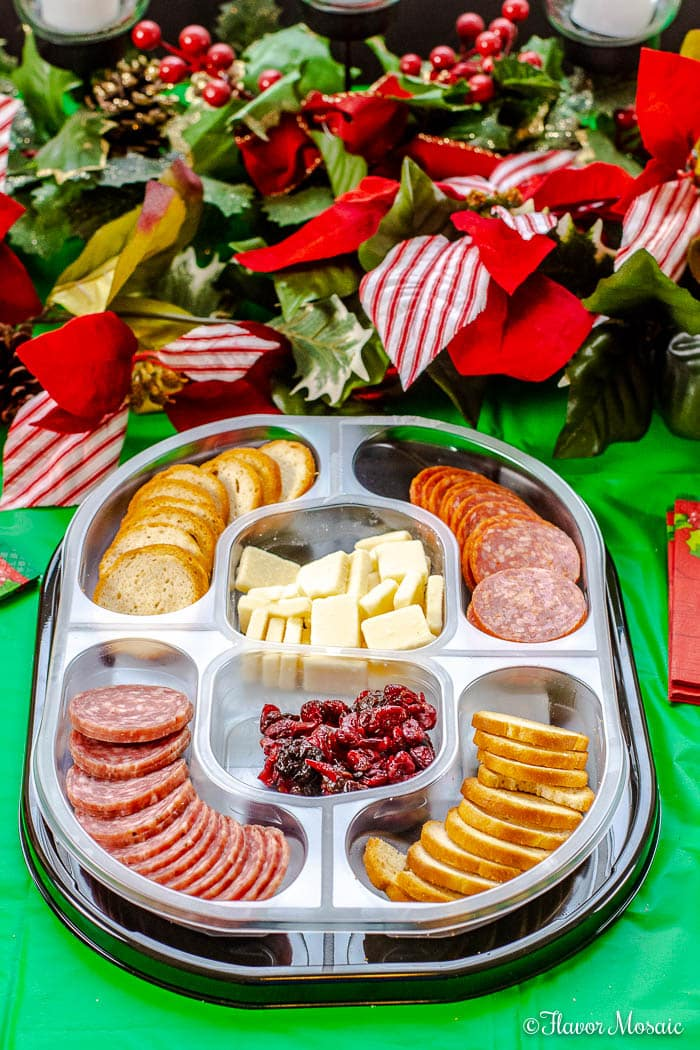 #ad Relax and enjoy your Holiday Party by serving the NEW Hillshire Snacking Social Platters with 5 delicious ingredients in one easy flip-and-serve tray.