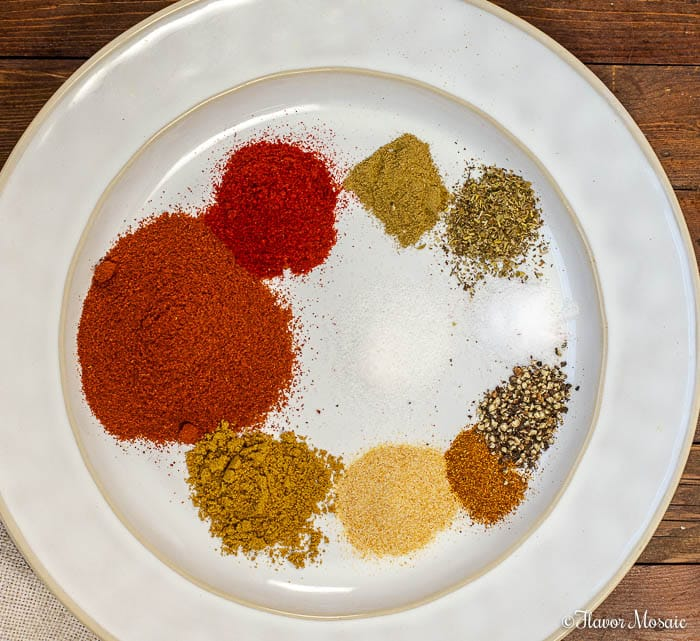 Photo in measured out spices on white plate for Homemade Chili Seasoning for Instant Pot Chili