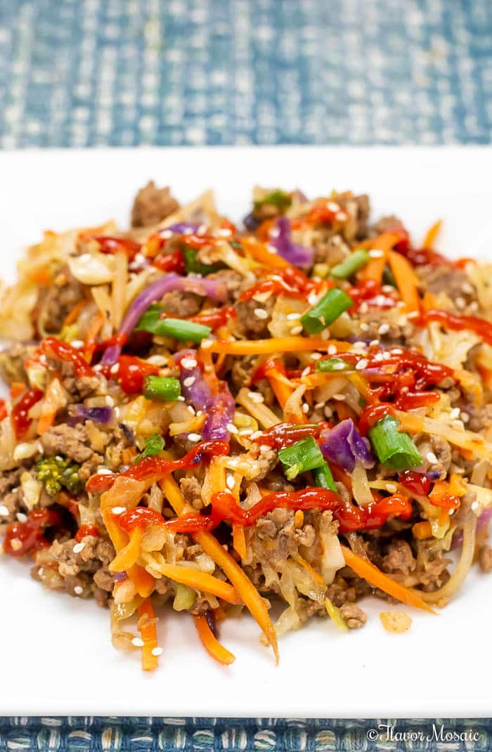 This Eggroll In A Bowl (Crack Slaw) is a one-skillet meal that is bursting with flavor and can be on the table in 20 minutes. It will keep everyone happy because it fits into Keto, Paleo, Whole30, Weight Watchers and Low Carb lifestyles!