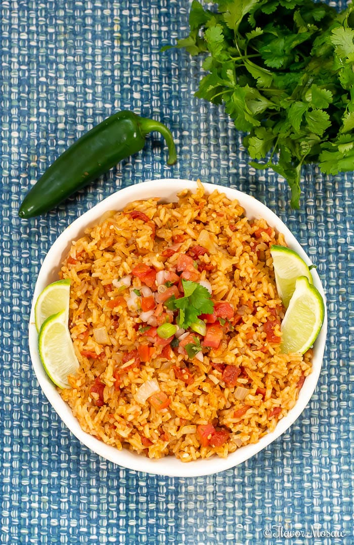 This Easy Homemade Mexican Rice, or Spanish Rice, is super flavorful with its bold savory flavors and makes a perfect side dish for your Mexican dinner.
