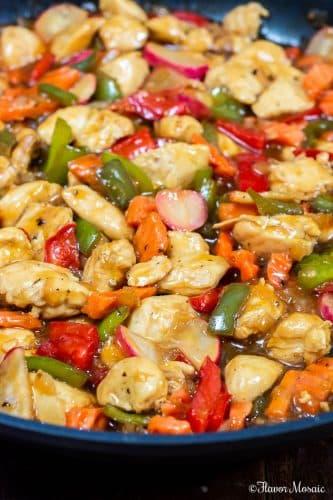 Close up of Teriyaki Chicken Stir Fry recipe iTeriyaki Chicken Stir Fry a black skillet