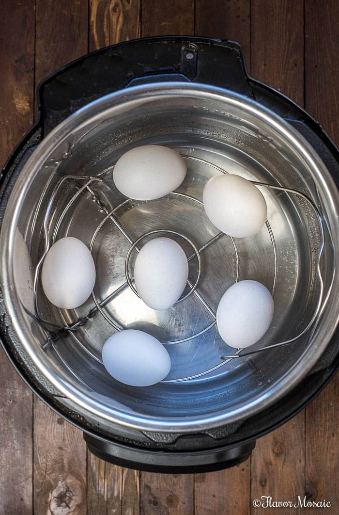 Overhead picture of 6 eggs inside an Instant Pot Pressure Cooker.