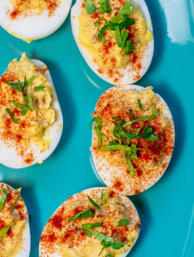 Overhead photo of Southern Deviled Eggs on blue plate