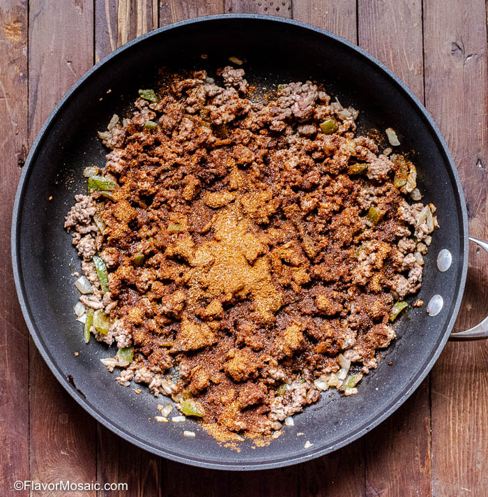 Browned Ground Beef in black skillet For Ground Beef Tacos