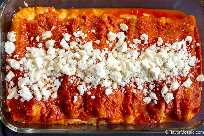 Overhead photo of horizontal casserole dish with Enchiladas Rojas de Queso.
