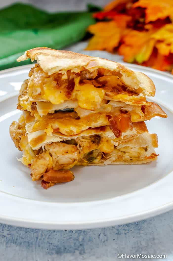 Side view of a stack of Chicken Bacon Ranch Quesadillas triangles.