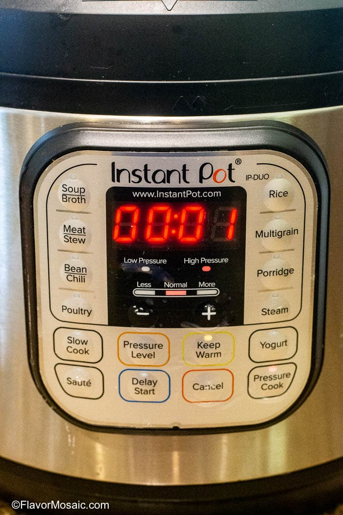 Photo of front of Instant Pot showing 1 minute pressure cook time.