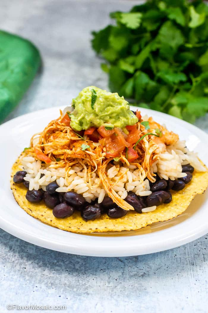 Instant Pot Chicken Tinga on tostada on white plate