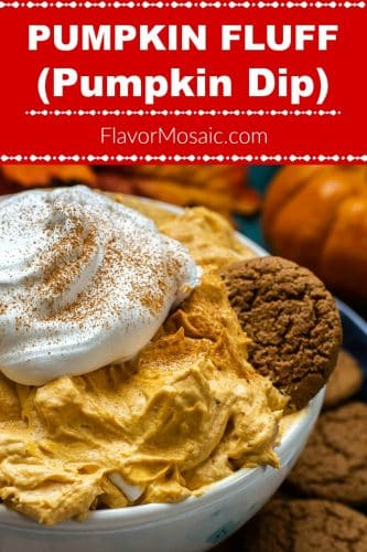 Pumpkin Fluff dip in a white bowl topped with a dollop of whipped cream and with a Gingersnap cookie dipping into it.