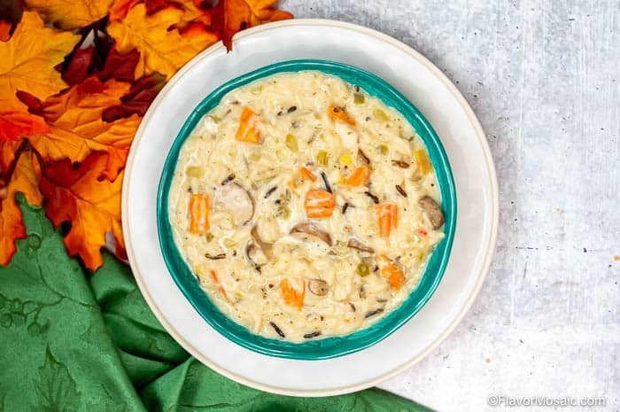 Horizontal photo of overhead view of bowl of Instant Pot Chicken And Wild Rice Soup