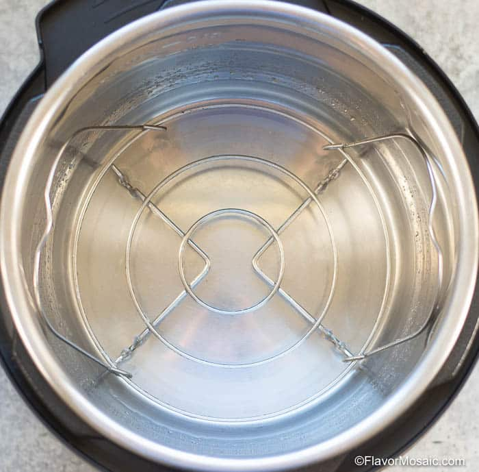 Overhead photo of Instant Pot with water and trivit inside inner liner pot.