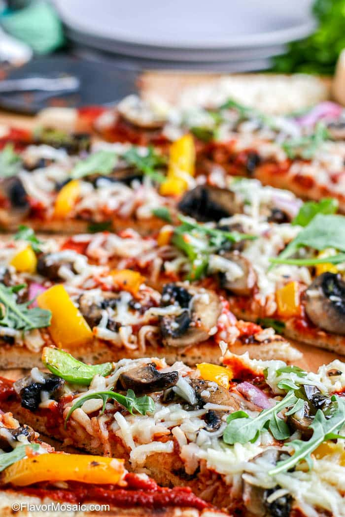 colorful photo of slices of grilled vegetable pizza.
