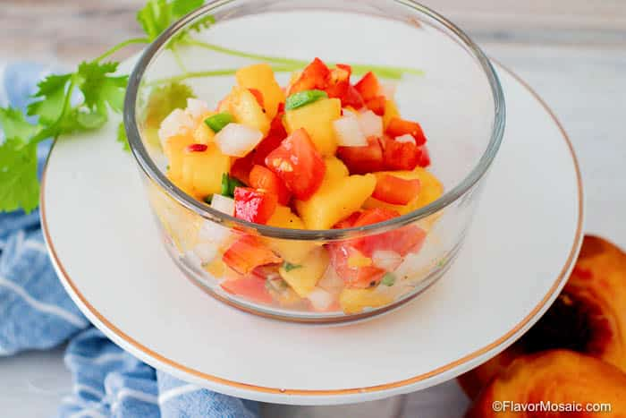 fresh peach salsa in glass bowl.