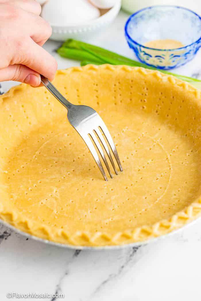 Fork pricking a pie crust