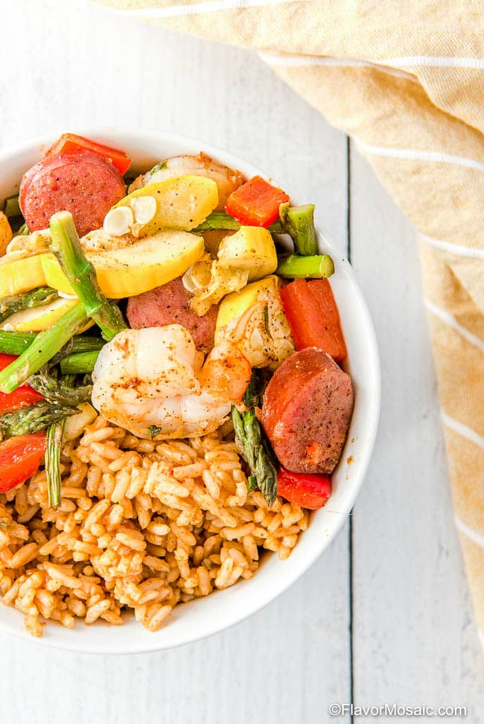 Overhead view of bowl of Cajun Shrimp and Sausage with Vegetables and Cajun Rice.