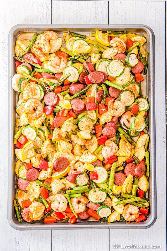 Overhead view of entire sheet pan of Cajun Shrimp and Sausage and vegetables.