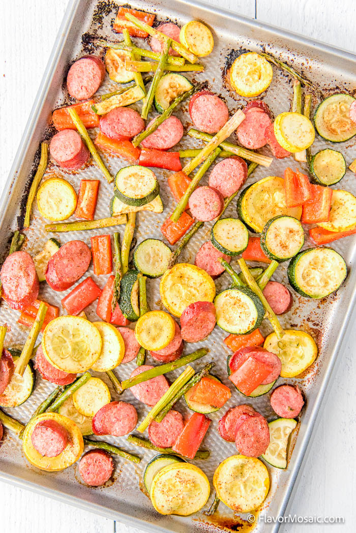 Overhead view of sheet pan with a variety of vegetables