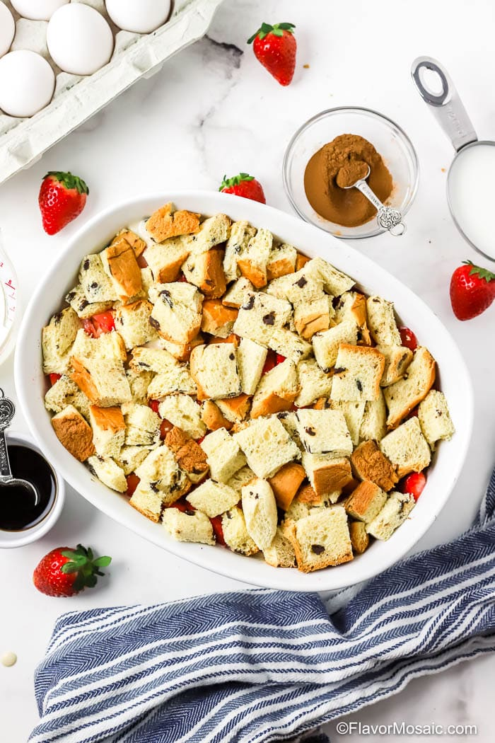French Toast Casserole Covered in top layer of pieces of bread.