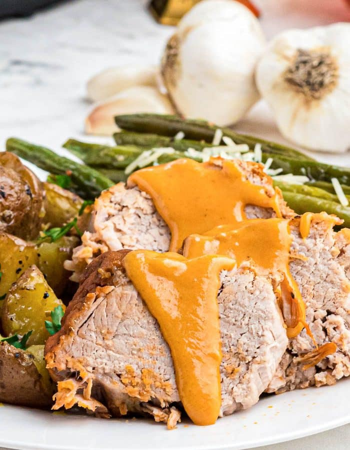 Slices of tender pork tenderloin covered in a orange maple sauce