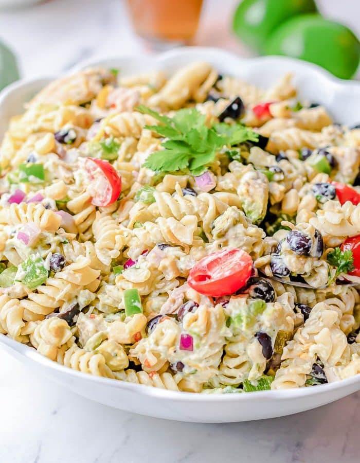 White bowl on marble counter filled with Mexican Chicken Southwest Pasta Salad with a Creamy Avocado dressing.