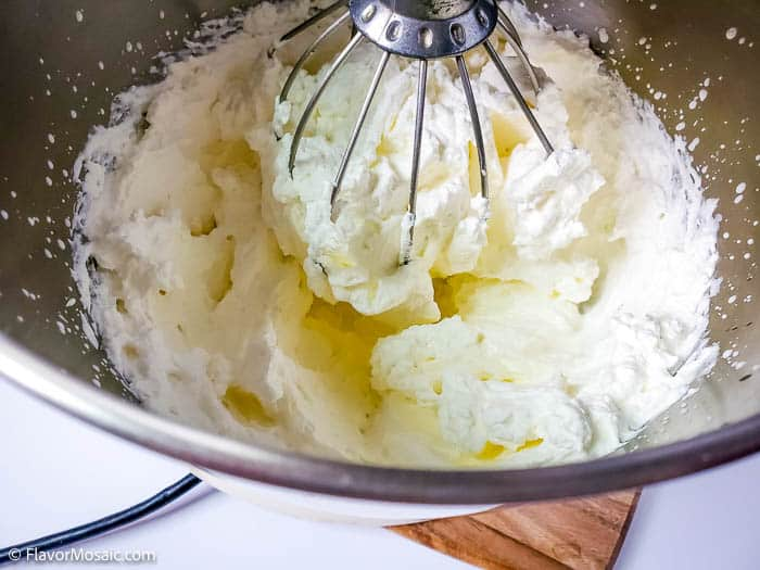 Whipping heavy cream in a stand mixer.
