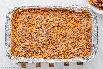 Layer of toffee chips on top of pumpkin magic bars.